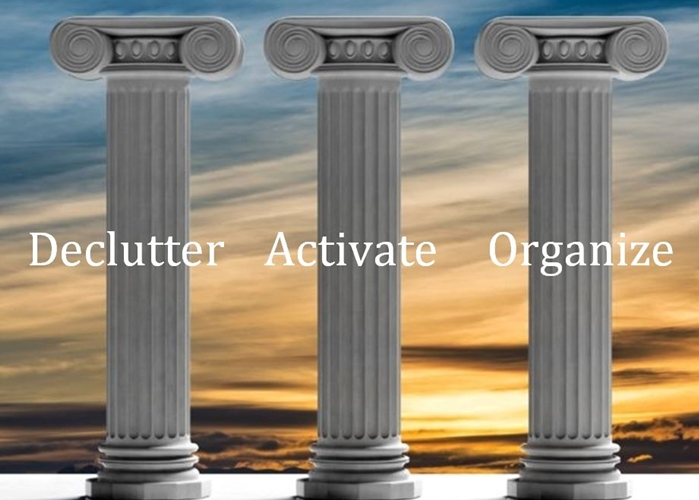 Three marble pillars with the words declutter, activate, organize written across the front